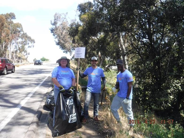 Photo of Volunteers Picking Up Trash